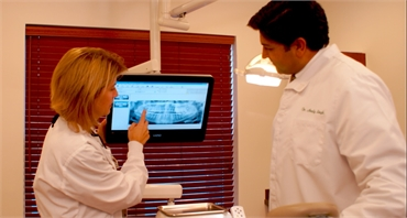 Clifton Park dentist checking dental report at Adirondack Dental Group