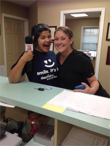 Amicable front desk staff at family dentistry Smile Dental Center