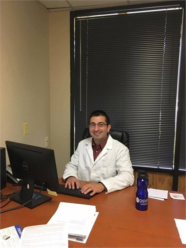 Our dentist Dr. Moumtaz in his office at Aces Dental Flagstaff AZ