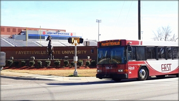 FAST city bus passing Fayetteville State University 6 miles away from O2 Dental Group of Fayettevill