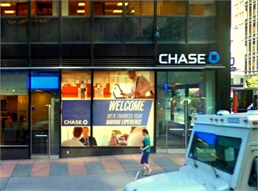 Chase Bank opposite Seventh Avenue is just a few paces to the west of 54th Street Dental NYC