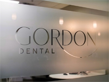 Signage on the window pane at Gordon Dental Kansas City MO 64151