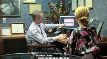 Kansas City dentist Dr. John Gordon explaining orthodontic treatment options to his patient