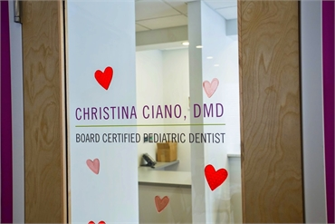 Signage on the door of our pediatric dentist Dr. Christina Ciano's office in Princeton NJ 08540