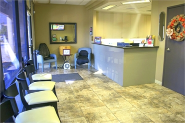 Waiting area and front desk at Center of Modern Dentisty Rancho Cucamonga CA 91730