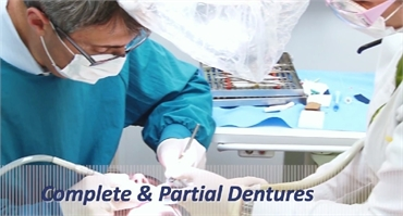 Denture specialists working on a patient at Powell Family Dental Care