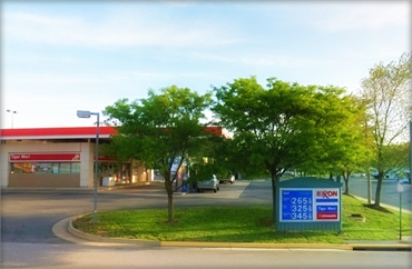 Exxon gas station on 13000 Worth Ave located 1.2 mile to the north of Woodbridge cosmetic dentistry
