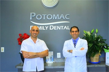 Woodbridge VA dentists Dr. Samer Khattab and Dr. Ahmed Uthman wth Potomac Family Dental signage in t