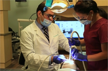 Woodbridge orthodontist Dr. Ahmed Uthman at work at Potomac Family Dental