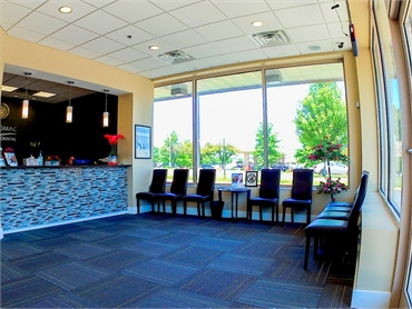 Waiting area and front desk at Potomac Family Dental