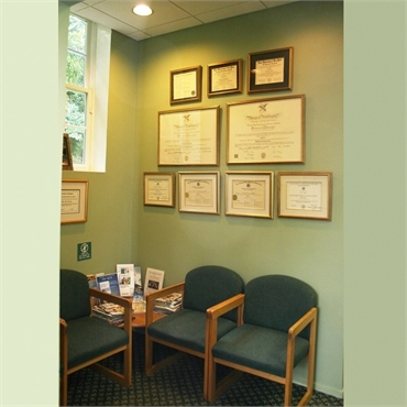 Waiting area and accolades display at Long Valley dentist Cazes Family Dentistry LLC