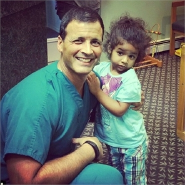 Long Valley dentist Dr. Jay Cazes shares lighter moments with happy patient at Cazes Family Dentistr