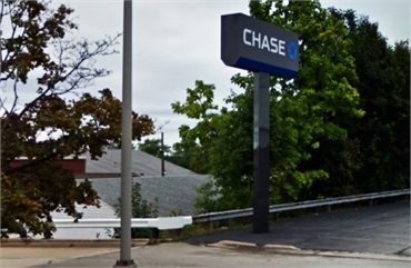 Chase Bank and ATM on 1805 Brittain Rd located just a few paces away to the north of Chapel Hill Den