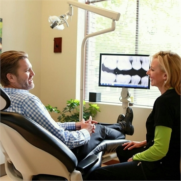 Dental hygienist at Harmony Dental with dental implant patient
