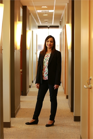 Renton dentist Dr. Pawandeep Kaur standing in the hallway at Renton Smile Dentistry