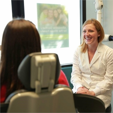 Portland cosmetic dentist Dr. Molly Marshall DDS talking to patient