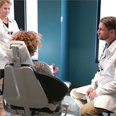 NE Portland dentist Dr. Kathan explains dental implant procedure to patient