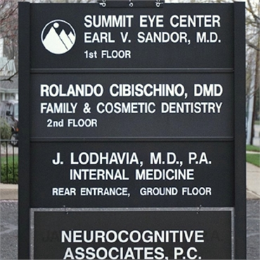 Signboard outside the office of Hackensack's top invisalign specialist Rolando Cibischino DMD