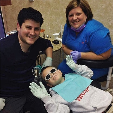 Pediatric dentist Dr. Andrew Simpson of South Shreveport Dental with his patient