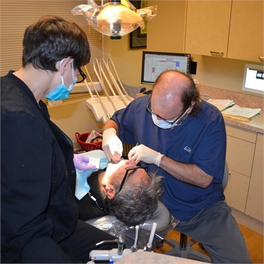 Dr. Hickey performing dental implants procedure at Sound to Mountain Dental Health Center Tacoma WA