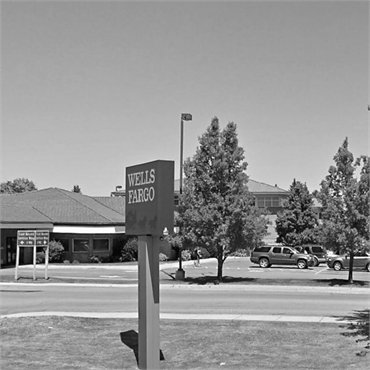 ATM Wells Fargo Bank few steps to the west of Post Falls dentist Woodland Family Dental