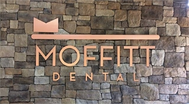 Signage on the wall at Moffitt Dental Center