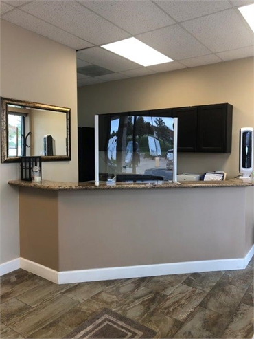Reception center equipped with plexiglass to ensure safety of patient at Ridgeview Dental