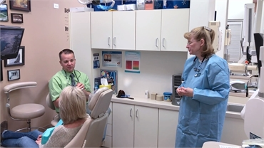 Centennial CO dentist Dr. Bassett explaining dental implant options to patient at Ridgeview Dental