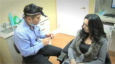 Toronto dentist Dr. Reyes explaining various dental implants options to patient