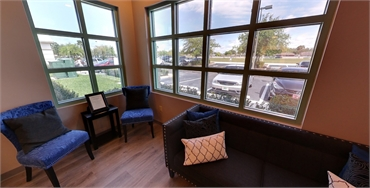 Comfy waiting area with outside view at New Port Richey dentist A Glamorous Smile