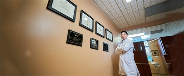 Renton cosmetic dentist Dr Hu with their Dental Degree at Hu Smiles