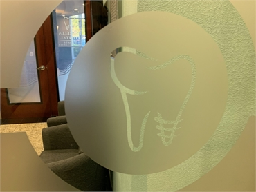 Logo on the entrance door at Chula Vista Estrella Dental
