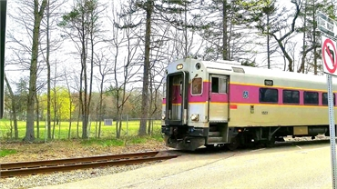 MBTA train arriving at Cohasset station at 4 minutes drive to the north of Freeman Dental Associates