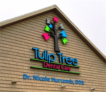 Signage on the building at South Bend dentist Tulip Tree Dental Care