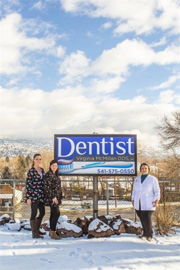Outdoors signboard at John Day dentist John Day Smiles