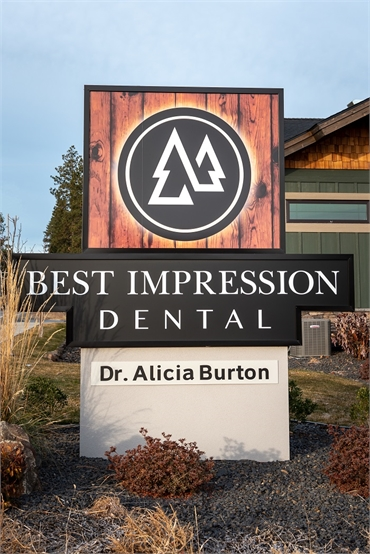 Signboard of Best Impression Dental Dr. Alicia G. Burton DDS at  the corner of Highway 902 and N. Le