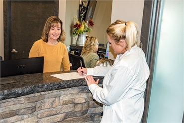 Treatment planning and checkout at Medical Lake cosmetic dentist Best Impression Dental Dr. Alicia G