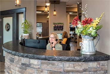 Renee at check in at the front desk at dental implants Medical Lake expert Best Impression Dental Dr