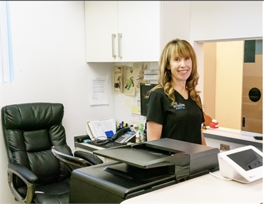 Warm and friendly front desk staff at Coral Springs dentist Wisdom Dental