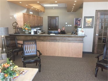 Friendly front desk staff at Sealy Dental Center in Katy