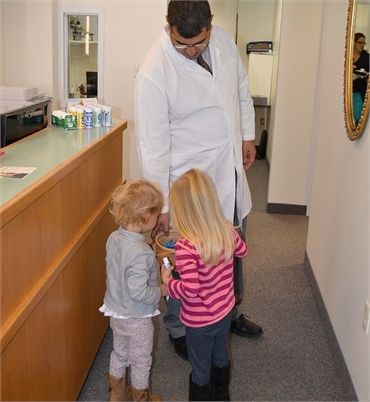 Hadley MA dentist Dr. Gogjini sharing lighter moments with kids