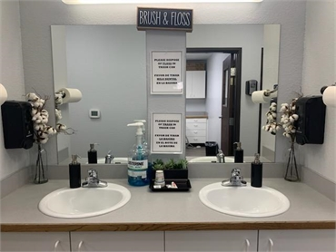 Brushing and flossing station at Comfort Dental Kids - Aurora