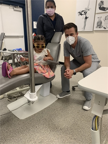 Dr. Flake sharing a joke with his little patient at Comfort Dental Kids - Centennial