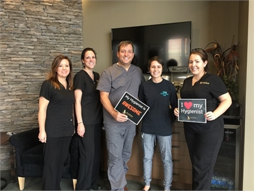 Columbia SC dentist Dr Griffin with hygienist team at WildeWood Aesthetic Dentistry