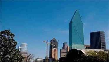 Downtown Dallas at 11 minutes drive to the south of Dallas dentist Fitz Dental