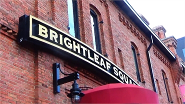 Brightleaf Square at 15 minutes drive to the northeast of O2 Dental Group of Durham
