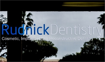 Window Sign of implant dentist Palm Beach Gardens  FL Andrew Rudnick DMD