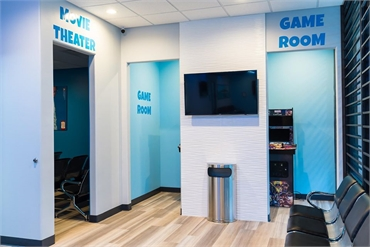 Movie theater and kids play area at Dallas dentist Fresca Dental