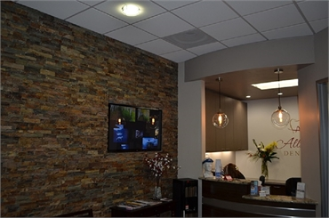 Reception area and multimedia section at San Marcos dentist Allred Dental