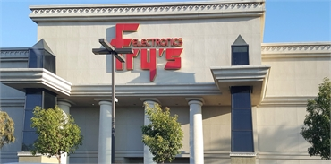 Fry's Electronics a few paces to the east of San Marcos dentist Allred Dental